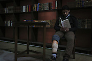 Dec. 29, 2015 - Aleppo, Syria - <br /> <br /> Syria Conflict<br /> <br /> Nur reads a book in the hair Nizar Qabbani paper in the cultural center in the city of Aleppo on December 29,2015 .Nour lost his leg following a bomb barrel attack by forces of Syria's President Bashar al-Assad near his house in Bustan al-Qasr district. A report from the Syrian Observatory for Human Rights (SOHR) claims that over 1,000 children have been killed in airstrikes during the nation'as ongoing civil war, an additional 1.5 million people have been wounded for life in the airstrikes that have been carried out by Syria' government since the Syrian conflict.<br /> ©Exclusivepix Media