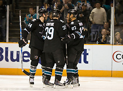 April 8, 2010; San Jose, CA, USA; San Jose Sharks center Logan Couture (39) celebrates after scoring a goal against the Vancouver Canucks with teammates center Manny Malhotra (27) and defenseman Marc-Edouard Vlasic (44) during the second period at HP Pavilion.  San Jose defeated Vancouver 4-2. Mandatory Credit: Jason O. Watson / US PRESSWIRE