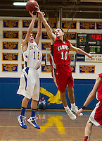 Sam Prescott's shot is blocked by Campbell's Max Gouveia during NHIAA Division III quarterfinal basketball action Saturday night at Gilford High School.  (Karen Bobotas/for the Laconia Daily Sun)