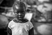 Three year old Malian girl Kadia Sangialiba poses for a photograph in the street in which she lives in Diabaly, Mali 26 January 2013. This photograph is part of a picture package of portraits showing children living along the same street in the small rice growing community of the northern Malian town of Diabaly who in the month of January 2013 lived through a rapid chain of events in the Malian war.