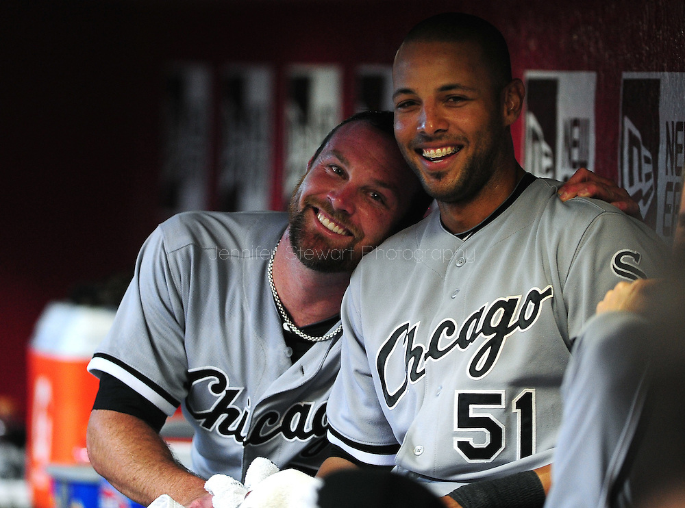 Jun. 18 2011; Phoenix, AZ, USA; Chicago White Sox pitcher John Danks (left) and outfielder Alex Rios (51) react in the dugout while playing against the Arizona Diamondbacks at Chase Field. Mandatory Credit: Jennifer Stewart-US PRESSWIRE..