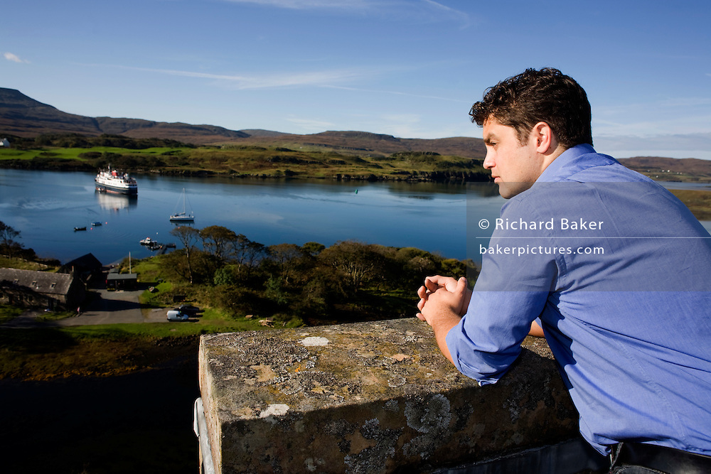 Hugh MacLeod, 30th Chief of the ancient Scottish clan MacLeod overlooks views from the ramparts of ancestral Dunvegan Castle