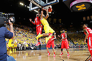 ANN ARBOR, MI - FEBRUARY 5: Jon Horford #15 of the Michigan Wolverines dunks for the ESPN television cameraman against Deshaun Thomas #1 of the Ohio State Buckeyes during the game at Crisler Center in Ann Arbor, Michigan on February 5. Michigan won 76-74. (Photo by Joe Robbins)