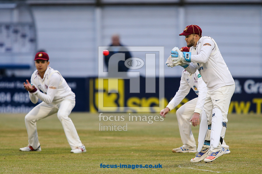 Ben Duckett of Northamptonshire CCC (right)  keeps wicket with the pink ball during the Specsavers County C'ship Div Two match at the County Ground, Northampton<br /> Picture by Andy Kearns/Focus Images Ltd 0781 864 4264<br /> 26/06/2017