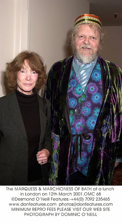 The MARQUESS & MARCHIONESS OF BATH at a lunch in London on 12th March 2001.	OMC 68