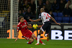 BOLTON, ENGLAND - Saturday, January 21, 2011: Liverpool's Daniel Agger in action against Bolton Wanderers' David Ngog during the Premiership match at the Reebok Stadium. (Pic by David Rawcliffe/Propaganda)