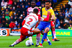 Jacob Mellis of Mansfield Town gets the ball through the legs of Luther Wildin of Stevenage - Mandatory by-line: Ryan Crockett/JMP - 27/04/2019 - FOOTBALL - One Call Stadium - Mansfield, England - Mansfield Town v Stevenage - Sky Bet League Two