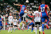 Crystal Palace midfielder, Mile Jedinak (15) battling for ball with Fulham midfielder, Kevin McDonald during the Pre-Season Friendly match between Fulham and Crystal Palace at Craven Cottage, London, England on 30 July 2016. Photo by Matthew Redman.