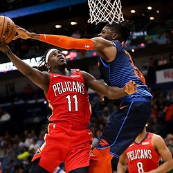 Feb 14, 2019; New Orleans, LA, USA; New Orleans Pelicans guard Jrue Holiday (11) shoots as Oklahoma City Thunder forward Nerlens Noel (3) defends during the second half at the Smoothie King Center. Mandatory Credit: Derick E. Hingle-USA TODAY Sports