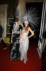 Left to right, models ANNA ILNYTSKA and TETYANA PISKUN at the 2006 Moet & Chandon Fashion Tribute in honour of photographer Nick Knight, held at Strawberry Hill House, Twickenham, Middlesex on 24th October 2006.<br />