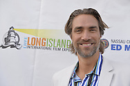 Bellmore, New York, USA. 16th July 2015. Actor LUKAS HASSEL is on the Red Carpet at the LIIFE Awards Ceremony at Bellmore Movies. Hassel was an award Presenter at the 18th Annual Long Island International Film Expo.