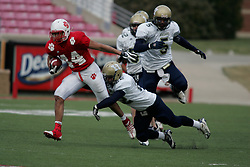 Beechwood hosted Hazard in the Class 1A Commonwealth Gridiron Bowl on Friday, Dec. 12, 2008, at Papa John's Cardinal Stadium in Louisville, Ky. Beechwood's Nieco Teipel, left, eludes Hazard defender Cory Slone. Teipel scored a touchdown in the first half along with teammate Matt Rigdon to put the Tigers up 14-0 at the half. (photo by Jonathan Palmer)