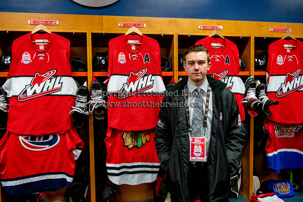 KAMLOOPS, CANADA - NOVEMBER 5:  Cody Glass #8 of Team WHL stands in front of his locker in the dressing room against the Team Russia on November 5, 2018 at Sandman Centre in Kamloops, British Columbia, Canada.  (Photo by Marissa Baecker/Shoot the Breeze)