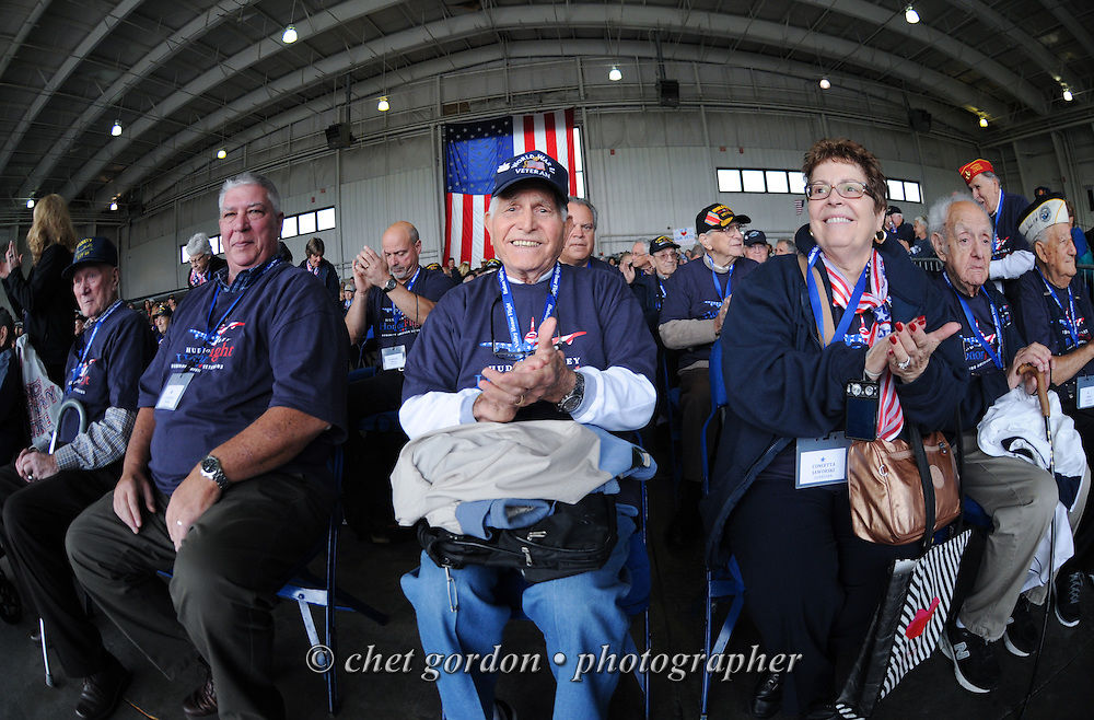 WWII Veterans and their escorts during a sendoff ceremony at Westchester County Airport in White Plains, NY on Saturday, October 18, 2014. Seventy-five WWII Veterans from the Westchester County area toured the WWII Memorial and Arlington National Cemetery onboard the inaugural flight from Westchester County Airport in White Plains, NY. Hudson Valley Honor Flight is a chapter of the Honor Flight Network, which provides free flights for WWII Veterans and tours of the WWII Memorial constructed in their honor, and other sites in the nation's capital.  © www.chetgordon.com