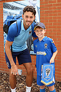 AFC Wimbledon defender Will Nightingale (5) with a fan during the EFL Sky Bet League 1 match between AFC Wimbledon and Rotherham United at the Cherry Red Records Stadium, Kingston, England on 3 August 2019.