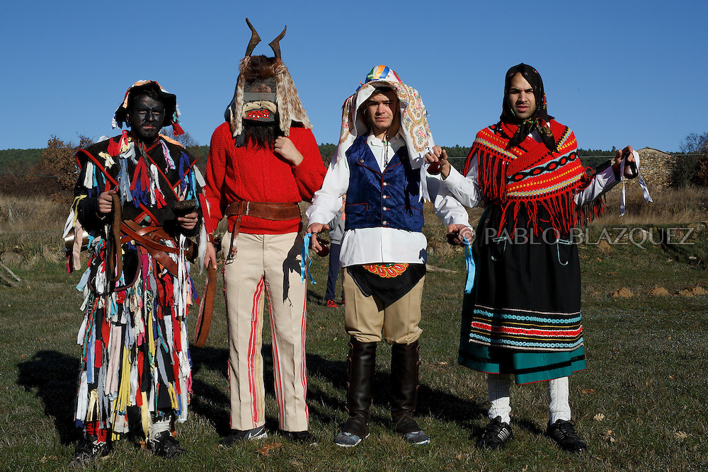 (L-R) Men dressed as La Filandorra, El Diablo, El Galan and La Madama poses for a picture during La Filandorra festival on December 26, 2016 in the small village Ferreras de Arriba, Zamora province, Spain.  La Filandorra festival is a pagan winter masquerade that takes place during Saint Esteban festivities. The parade is represented by four characters, La Filandorra, El Diablo (Devil), La Madama (madame) y El Galán (Gallant). (© Pablo Blazquez)