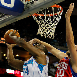 January 4, 2012; New Orleans, LA, USA; New Orleans Hornets power forward Carl Landry (24) shoots as Philadelphia 76ers center Spencer Hawes (00) defends during the first quarter of a game at the New Orleans Arena.   Mandatory Credit: Derick E. Hingle-US PRESSWIRE