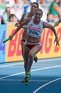(L) Weronika Wedler and (R) Ewelina Ptak both from Poland compete in women's relay 4x100 meters qualification during the 14th IAAF World Athletics Championships at the Luzhniki stadium in Moscow on August 18, 2013.<br /> <br /> Russian Federation, Moscow, August 18, 2013<br /> <br /> Picture also available in RAW (NEF) or TIFF format on special request.<br /> <br /> For editorial use only. Any commercial or promotional use requires permission.<br /> <br /> Mandatory credit:<br /> Photo by © Adam Nurkiewicz / Mediasport