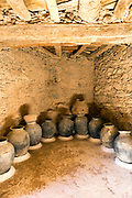 AMTOUDI, MOROCCO - JUNE 2ND 2016 - Ancient Berber Ceramic Pots inside Amtoudi Granary (Agadir Id Aissa) fortified walls and room chambers, Guelmim province of Southern Morocco.