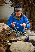 Mark Greeno, age 55, rigging top ropes at Palisades State Park in Eastern South Dakota on March 26, 2010..