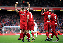Liverpool's Steven Gerrard celebrates scoring his side's third goal of the game during the Legends match at Anfield Stadium, Liverpool.