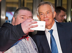 © Licensed to London News Pictures. 04/01/2018. London, UK.  Former British Prime Minister TONY BLAIR poses for a photograph with a member of the public as he leaves BBC Broadcasting House following a Radio 4 interview. Mr Blair discussed the EU referendum and refuted claims in a new book that he shared rumours that the UK was spying on the Trump election campaign. Photo credit: Ben Cawthra/LNP