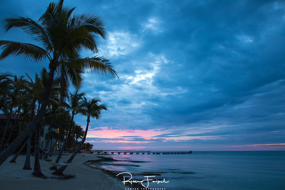 Key West is a favorite location of mine for scenes like this.  I've always heard that if you don't like the weather in Florida just wait a few minutes.  It started as a dull morning but soon the sun started painting the sky which really added to this shot.