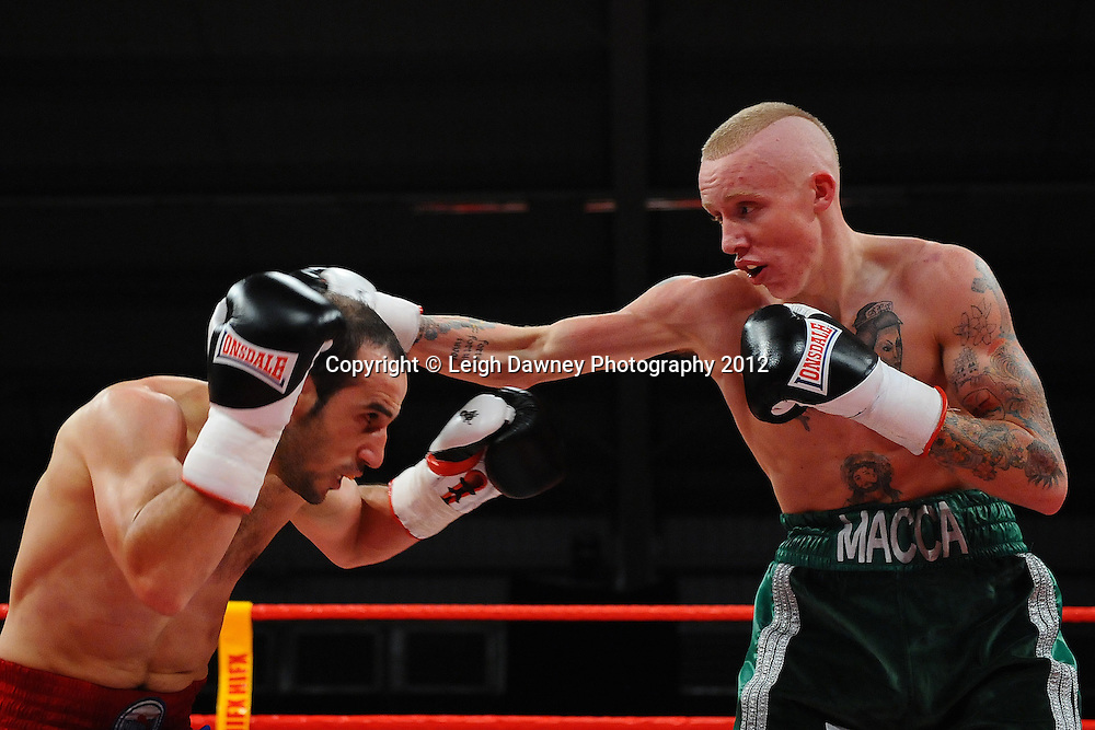 Youseff Al Hamid (blue shorts) defeats Tommy Carus in a 4x3 Lightweight contest on the 30th November 2012 at Aintree Equestrian Centre, Aintree, Liverpool. Frank Maloney Promotions. Pictures by Leigh Dawney. ©leighdawneyphotography 2012.