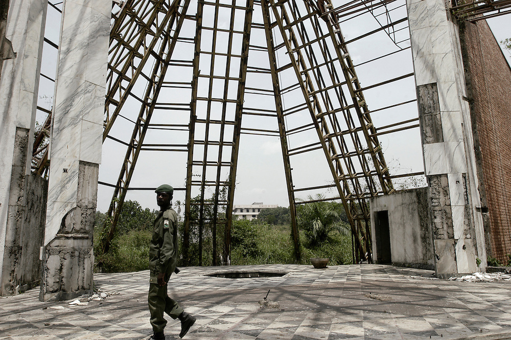 A soldier in the remains of a chapel built on the grounds of the Bamboo Palace, one of the extravagant residences built by Mobutu Sese Seko and used primarily for public functions in his native village in Equateur Province..Gbadolite, DR Congo. 17/03/2009.Photo © J.B. Russell