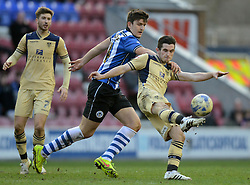 Leeds United's Lewis Cook competes with Wigan Athletic's Harry Maguire - Photo mandatory by-line: Richard Martin-Roberts/JMP - Mobile: 07966 386802 - 07/03/2015 - SPORT - Football - Wigan - DW Stadium - Wigan Athletic v Leeds United - Sky Bet Championship
