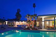 Illuminated patio at poolside in luxurious villa at night