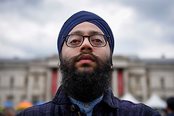 © Licensed to London News Pictures. 29/04/2017. London, UK. A visitor enjoys the Sikh festival of Vaisakhi taking place in Trafalgar Square and hosted by the Mayor of London.  The festival celebrates the beginning of Sikhism, a collective faith which is practiced by more than 20 million people worldwide.   Photo credit : Stephen Chung/LNP