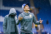 Leeds United defender Ezgjan Alioski (10) reacts to the weather after arriving at the ground during the EFL Sky Bet Championship match between Sheffield Wednesday and Leeds United at Hillsborough, Sheffield, England on 26 October 2019.
