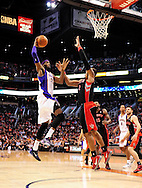 Jan. 24, 2012; Phoenix, AZ, USA; Phoenix Suns forward Hakim Warrick (21) puts up a shot against the Toronto Raptors forward James Johnson (2) during the second half at the US Airways Center. The Raptors defeated the Suns 99-96. Mandatory Credit: Jennifer Stewart-US PRESSWIRE..