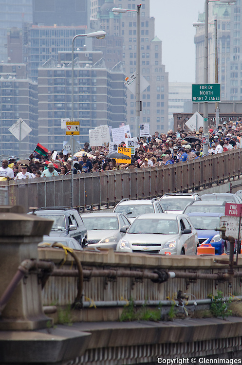 20Jul2013 / Brooklyn, NY, USA // Marchers walk across Brooklyn Bridge to protest the recent acquittal of George Zimmerman in the shooting of Trayvon Martin.