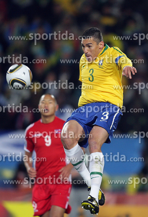 15.06.2010, Ellis Park, Johannesburg, RSA, FIFA WM 2010, Brasilien vs Nordkorea im Bild LUCIO of Brazil in action  as JONG Tae Se of North Korea looks on, EXPA Pictures © 2010, PhotoCredit: EXPA/ IPS/ Mark Atkins / SPORTIDA PHOTO AGENCY