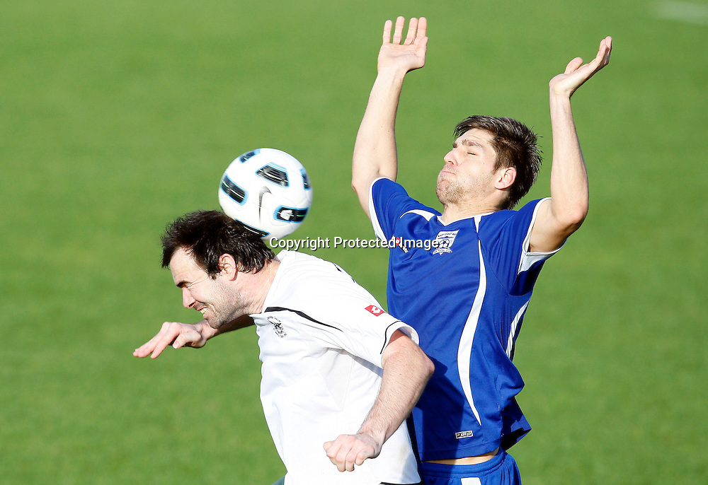 Onehunga's Scott Foster gets his head to the ball ahead of Bays Ryan Zoghby. Chatham Cup, Round Three, East Coast Bays v Onehunga Sports, Bay City Park, Saturday 18th June 2011. Photo: Shane Wenzlick