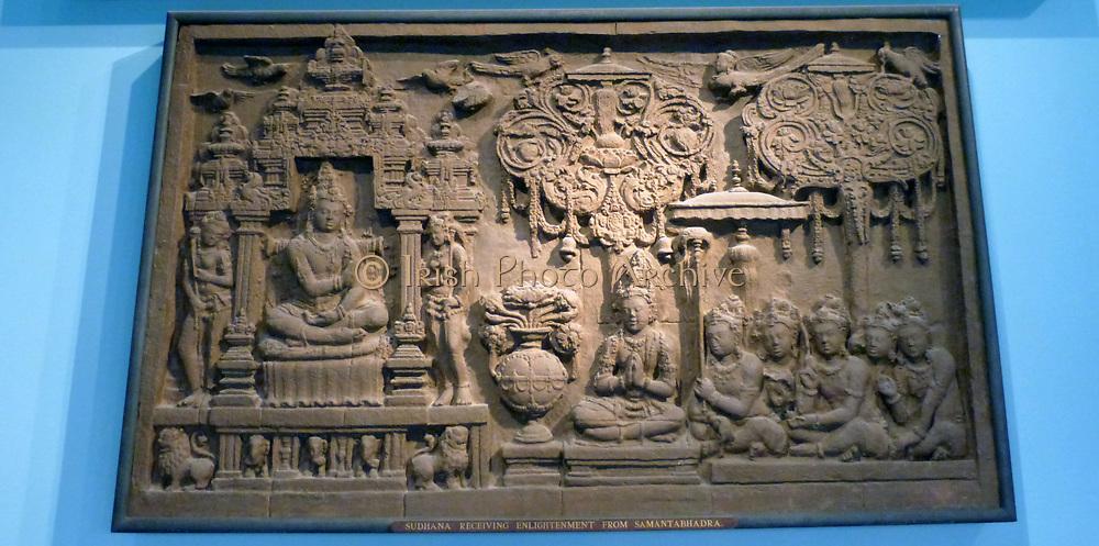 Sudhana receiving enlightenment from Samantabhadra.  Plaster cast of original relief of 700-800 Borobudur, Java.