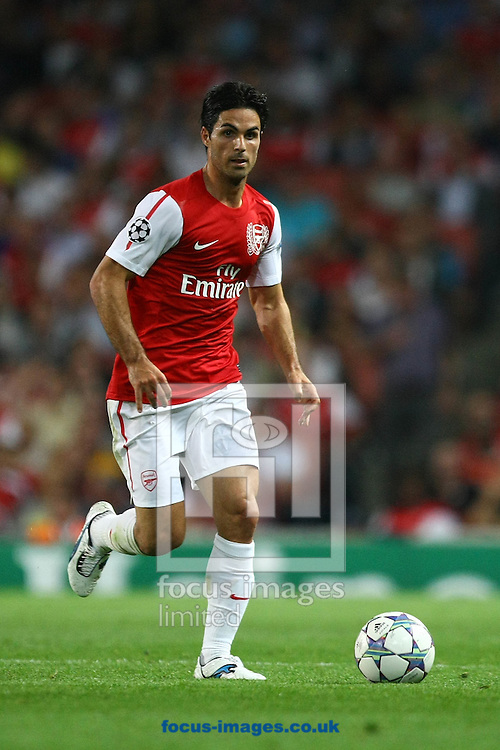 Picture by Paul Chesterton/Focus Images Ltd. 07904 640267.28/9/11.Mikel Arteta of Arsenal in action during the UEFA Champions League Group F match at The Emirates Stadium, London.