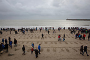 "The commminuty gather to remember fallen soldiers on the beach in Folkestone as part of Danny Boyle's 'Pages of the Sea""  Armistice Day event commemorating 100 years since the end of the First World War on remembrance day the 11th of November 2018. Sunny Sands beach, Folkestone, Kent, United Kingdom.  (photo by Andrew Aitchison / In pictures via Getty Images)"