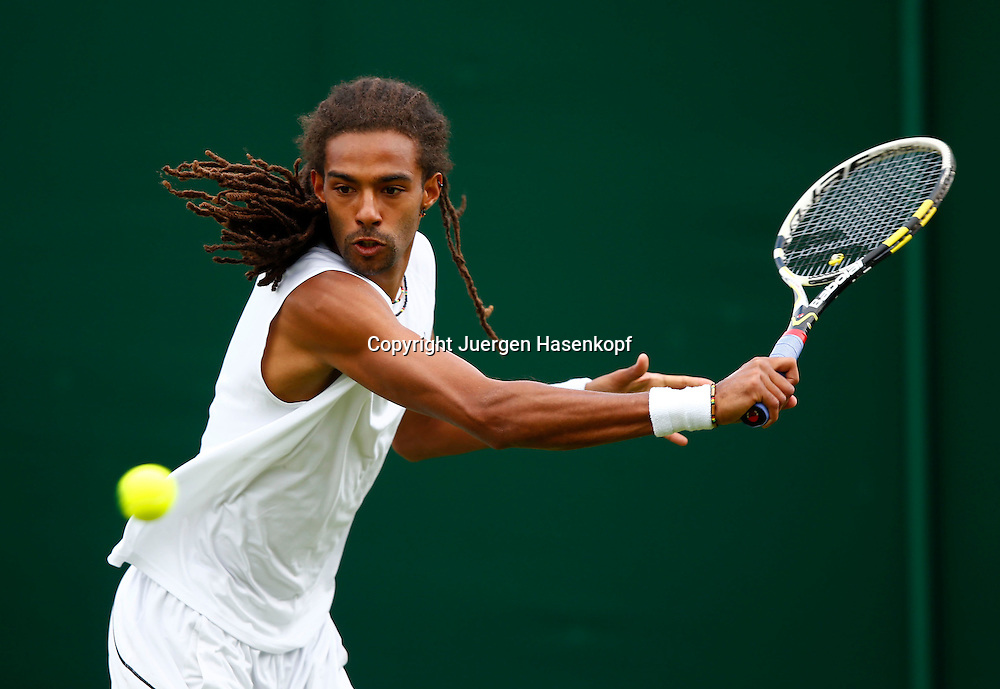 Wimbledon Championships 2013, AELTC,London,<br /> ITF Grand Slam Tennis Tournament, Dustin Brown (GER),Aktion,Einzelbild,<br /> Halbkoerper,Querformat,