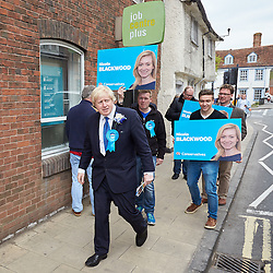 © Licensed to London News Pictures.  02/05/2015. ABINGDON, UK. Boris Johnson (centre left) walks past a job centre while campaigning in Abingdon with Nicola Blackwood (not seen) who is standing for re-election as MP for the Oxford West and Abingdon constituency.  Photo credit: Cliff Hide/LNP