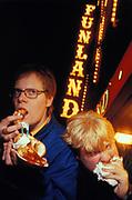 Two men eating fast food, Blackpool, UK, 1998.