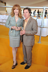 STEFANIE POWERS and KENNEY JONES at the 2011 Veuve Clicquot Gold Cup Final at Cowdray Park, Midhurst, West Sussex on 17th July 2011.
