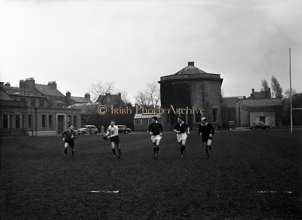 Irish Rugby Football Union, Ireland v Wales, Five Nations, Irish team practice, Dublin, Ireland, Friday 14th March, 1958,.14.3.1958, 3.14.1958,. . Irish Team, ..J G M W Murphy, Wearing number 15 Irish jersey, Full Back, London Irish Rugby Football Club, Surrey, England, ..A J O'Reilly, Wearing number 14 Irish jersey, Right Wing, Old Belvedere Rugby Football Club, Dublin, Ireland,  ..N J Henderson, Wearing number 13 Irish jersey, Captain of the Irish team, Right centre, N.I.F.C, Rugby Football Club, Belfast, Northern Ireland, ..D Hewitt, Wearing number 12 Irish jersey, Left centre, Queens University Rugby Football Club, Belfast, Northern Ireland,..A C Pedlow, Wearing number 11 Irish jersey, Left wing,  C I Y M S Rugby Football Club, Belfast, Northern Ireland, ..M A English, Wearing number 10 Irish jersey, Outside Half, Bohemians Rugby Football Club, Limerick, Ireland, ..J A O'Meara, Wearing number 9 Irish jersey, Scrum Half, Dolphin Rugby Football Club, Cork, Ireland, ..P J O'Donoghue, Wearing  Number 1 Irish jersey, Forward, Bective Rangers Rugby Football Club, Dublin, Ireland, ..A R Dawson, Wearing number 2 Irish jersey, Forward, Wanderers Rugby Football Club, Dublin, Ireland, . .B G Wood, Wearing number 3 Irish jersey, Forward, Garryowen Rugby Football Club, Limerick, Ireland, ..J B Stevenson, Wearing number 4 Irish jersey, Forward, Instonians Rugby Football Club, Belfast, Northern Ireland,..W A Mulcahy, Wearing number 5 Irish jersey, Forward, University College Dublin Rugby Football Club, Dublin, Ireland, ..J A Donaldson, Wearing number 6 Irish jersey, Forward, Collegians Rugby Football Club, Belfast, Northern Ireland, ..J R Kavanagh, Wearing number 7 Irish jersey, Forward, Wanderers Rugby Football Club, Dublin, Ireland, ..N A Murphy, Wearing number 8 Irish jersey, Forward, Cork Constitution Rugby Football Club, Cork, Ireland,.
