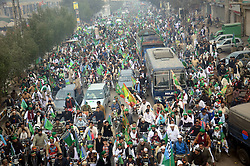 December 12, 2016 - Lahore, Punjab, Pakistan - Pakistani faithful people participate in a procession of Eid Milad-un-Nabi (PBUH) marking the birth anniversary of Islam's Prophet Muhammad in Lahore. Muslims all over the world celebrate the birthday of Holy Prophet Muhammad (PBUH) by participating in religious processions, ceremonies and by distributing free meals to the poor. (Credit Image: © Rana Sajid Hussain/Pacific Press via ZUMA Wire)