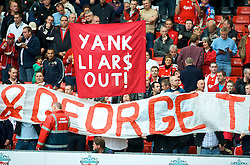 "LIVERPOOL, ENGLAND - Saturday, September 26, 2009: Liverpool supporters on the Spion Kop display banners reading ""YANK LIARS OUT!"" and ""TOM AND GEORGE TELL LIES"" regarding the many broken promises made by American co-owners Tom Hicks and George Gillett before the Premiership match against Hull City at Anfield. (Photo by: David Rawcliffe/Propaganda)"
