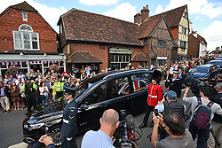 © Licensed to London News Pictures. 10/07/2020. Ditchling, UK. A hearse carrying the coffin passes through the town of Ditchling, East Sussex as members of the public gather to pay their respects ahead of the funeral of Dame Vera Lynn. The 'Forces' Sweetheart', who died last month aged 103, was famous for singing performances during WW2, which helped raise morale amongst troops abroad. Photo credit: Ben Cawthra/LNP