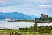 Caledonian Macbrayne - Calmac - ferry on Sound of Mull leaves Craignure past Duart Castle (home of Maclean clan) on Isle of Mull in the Inner Hebrides and Western Isles, West Coast of Scotland