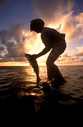 A nice catch and a fantastic sunset over the water.